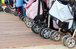 Strollers parked on the parquet floor Stock Photos