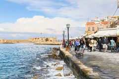 Strolling along Chania promenade Royalty Free Stock Photo