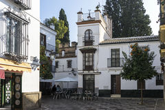 Strolling through the ancient streets of Seville and today judera neighborhood called Santacruz Stock Photo