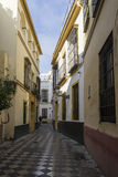 Strolling through the ancient streets of Seville and today judera neighborhood called Santacruz Royalty Free Stock Images
