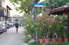 Strolling cobblestone streets of Bulgaria's resort town of Sozopol. Vacationing tourists enjoy strolling cobblestone streets of Bulgaria's Black stock photos
