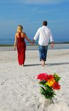 Strolling couple on beach Stock Photos