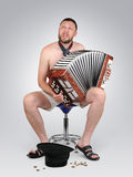 The strolling musician with a bayan sings Stock Photo