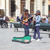 Strolling musician. STOCKHOLM, SWEDEN - May 21, 2015: Unidentified strolling musicians play guitars on Stortorget square in Stockholm Royalty Free Stock Images