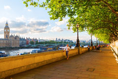 Strolling people on the Thames promenade Royalty Free Stock Photo