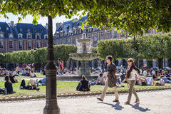 Strolling in Place des Vosges, Paris Royalty Free Stock Image
