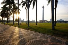 Strolling in public park of National Monument Monas, Jakarta. Jakarta has vast park in the centre of city, as Jakarta landmark. national monument or monas stock image
