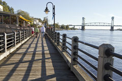Strolling the Water Street Boardwalk in Wilmington, NC Stock Images