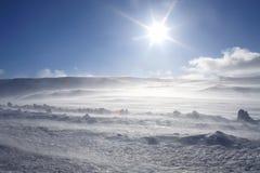 Strom de la nieve con el sol Imágenes de archivo libres de regalías
