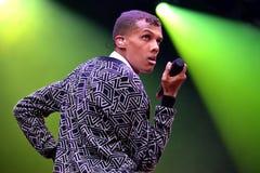 Stromae,演奏议院、新的敲打和电子音乐的比利时歌手 库存图片