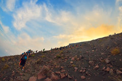 STROMBOLI VOLCANO, ITALY - AUGUST 2015: Group of tourists hiking on top of the Stromboli Volcano in the Aeolian Islands, Sicily, I Stock Image