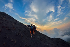 STROMBOLI VOLCANO, ITALY - AUGUST 2015: Group of tourists hiking on top of the Stromboli Volcano in the Aeolian Islands, Sicily, I Stock Photography