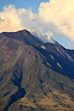 Stromboli volcano, Sicily. Island of Stromboli with smoke issuing from the mouth of the volcano Royalty Free Stock Images
