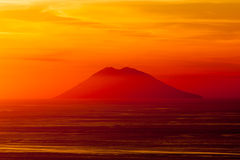Stromboli volcano at sunset Royalty Free Stock Images