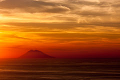 Stromboli volcano at sunset. A view of Stromboli from mainland Italy royalty free stock image