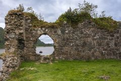 Window in wall of Castle Strome with Loch Carron, Scotland. Royalty Free Stock Photos