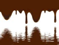 Stromende chocolade over het water Stock Afbeeldingen