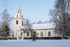 Stroms kyrka i vinter, Stromsund, Sverige arkivbilder
