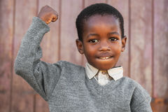 Strong. Little boy is showing off his muscles to the photographer stock photos