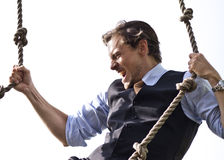 Strong, able businessman climbing ropes Royalty Free Stock Images