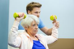 Strong active elderly woman. Strong active elderly women dumbbells royalty free stock image