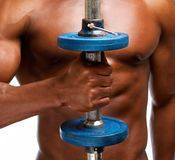 Strong african american man lifting gym weight. Close up portrait of a strong african american man lifting gym weight Royalty Free Stock Photography