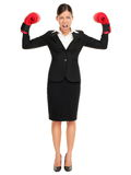 Strong aggressive business woman concept. Strong aggressive business winner woman concept. Businesswoman wearing boxing gloves showing flexing muscles standing stock photos