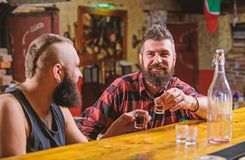 Strong alcohol drinks. Friday relaxation in bar. Friends relaxing in bar pub. Cheers concept. Lets get drunk. Hipster. Brutal bearded men spend leisure with royalty free stock photo