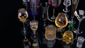 A set of strong alcoholic beverages in glasses, in the presence of whiskey, vodka, rum, brandy, tequila, on a dark background stock image