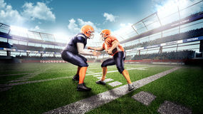 Strong american football players in the action. Professional american football players in the action on stadium Stock Photography