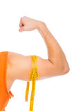 Strong arm with tailor tape Royalty Free Stock Photography