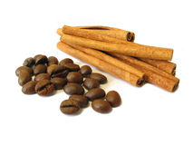 Strong Aromas. Cinnamon sticks and coffee beans with shadow on a white background Royalty Free Stock Images
