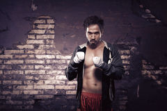 Strong asian boxer with strap in his hand waiting for fight Royalty Free Stock Images