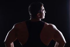 Strong athlete. Back of strong athlete in black undershirt Royalty Free Stock Images
