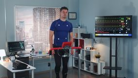 Strong athlete doing cardiac stress test on racetrack. In sport lab with modern equipment. In Scientific Sports Laboratory stock video