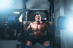 Strong athlete exercise with weight in fit gym. Fitness training with weight. Bodybuilding workout Royalty Free Stock Photos