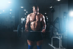 Strong athlete exercise with weight in fit gym Royalty Free Stock Photography