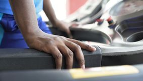Strong athlete exercising on treadmill in the fitness club, sport and healthcare. Stock footage stock video footage