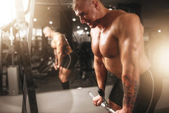 Strong athlete with muscular body lifting barbell Royalty Free Stock Photography
