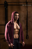 Strong athlete in sweatshirt. Portrait of strong bodybuilder young man wearing sweatshirt royalty free stock image