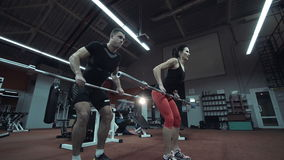 Strong athletic couple working out in a gym