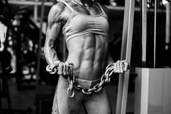 Free Strong Athletic Female Body. Muscular Woman With Heavy Chain Stock Photo - 73246390