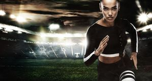 A strong athletic, women sprinter, running on staidum wearing in the sportswear, fitness and sport motivation. Runner Royalty Free Stock Photos