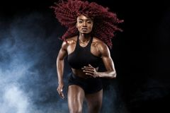 A strong athletic, female sprinter, running at sunrise wearing in the sportswear, fitness and sport motivation concept. A Strong athletic, female runner on the royalty free stock photo