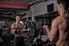 Strong athletic guy in the gym Royalty Free Stock Images
