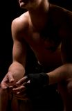Strong athletic man on black background. Strong athletic man in front of  black background Stock Image