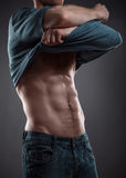 Strong athletic man. On black background Royalty Free Stock Photography