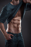 Strong athletic man stock images