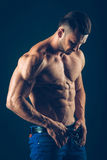 Strong athletic man  on black background. To pump Stock Photo