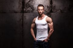 Strong athletic man on dark grunge background royalty free stock photography